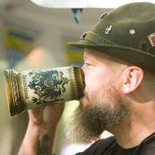 Eric Schroeder, Indianapolis, raises a stein at the German American Klub's Oktoberfest in September 2012.