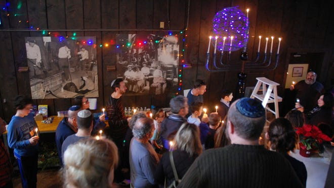 Local Jewish faithful celebrate a pre-Hanukkah lighting ceremony Sunday, Dec. 18, 2016.