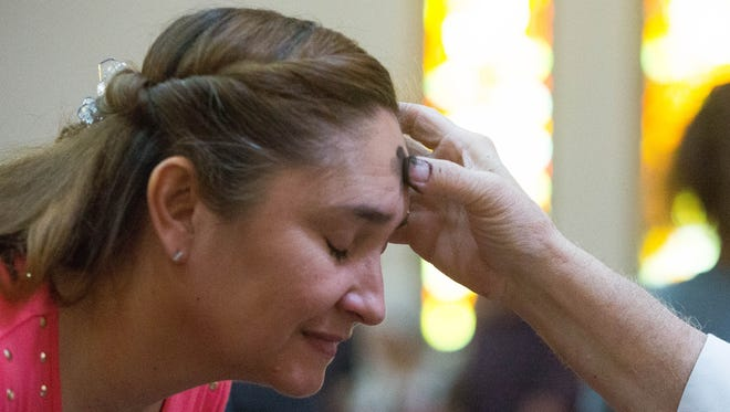 Sylvia D'Andrea, recieves ashes from Deacon Ed Misquez during services at the Cathedral of Immaculate Heart of Mary, Wednesday March 1, 2017 during Ash Wednesday services. Ash Wednesday is the beginning of the Lenten season.  Many people associate Lent with giving up something like chocolate or a habit they have, but Many Christians will celebrate the season of Lent by praying or fasting for 40 days.
