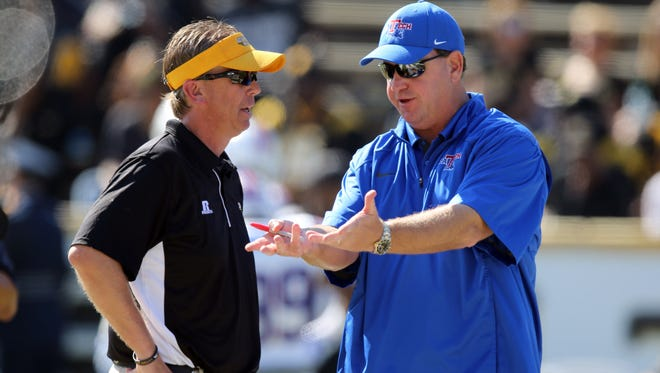 Southern Miss coach Todd Monken and Louisiana Tech Bulldogs coach Skip Holtz talk before their game in 2014.