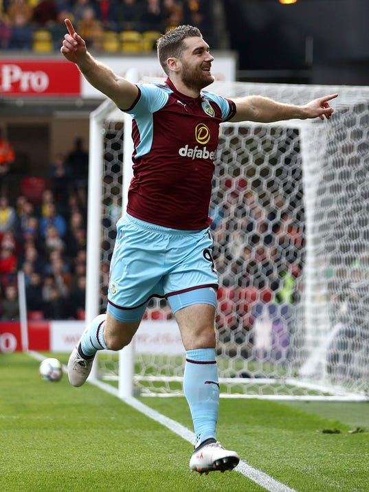 Burnley's Sam Vokes celebrates scoring his side's first goal of the game during the English Premier League soccer match between Watford and Burnley at Vicarage Road, Watford, England. Saturday, April 7, 2018 (John Walton/PA via AP)