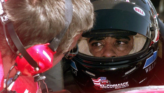 Willy T. Ribbs with team manager Brad McCanless during a 1999 Indycar race in Las Vegas.