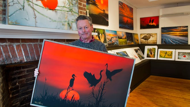 Photographer Kevin Fleming displays a sunset scene at his new permanent gallery in Lewes.
