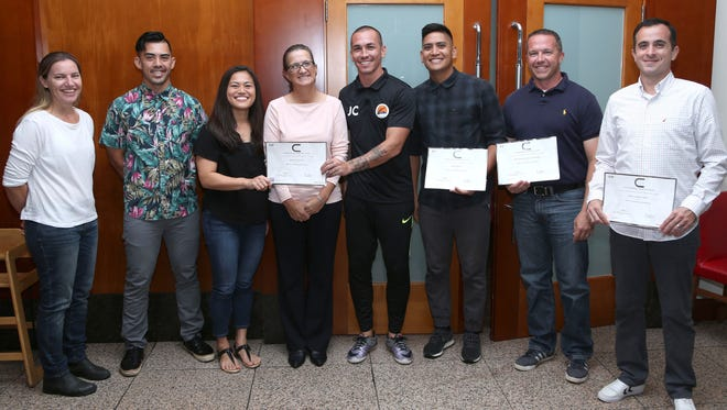 "Five coaches from Guam recently earned their AFC ""C"" Coaching License certificate and were recognized in a presentation ceremony at the Fiesta Resort Guam hosted by Guam Football Association. From left: GFA Technical Director Belinda Wilson; GFA Coach Education Development Officer Dominic Gadia; Koharu Minato; GFA acting General Secretary Cheri Stewart; Jason Cunliffe; Ian Mariano; Phillip Santomauro; and Jorge Hellu."