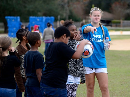 "Sophie Kallas and other players from Western Washington University play soccer games with students at MacArthur Elementary School on Wednesday as part of the NCAA Division II soccer outreach program. Soccer teams from all over the country, four men's teams and four women's teams, have arrived in Pensacola for the NCAA II Final Four hosted by the University of West Florida at Asthon Brosnaham Park. In addition to tournament play, the teams are visiting schools this week to get kids excited about soccer and stress the importance of studying in addition sports. ""Every time they have made it to the final four this is what they look forward to the most,"" said head coach Travis Connell."