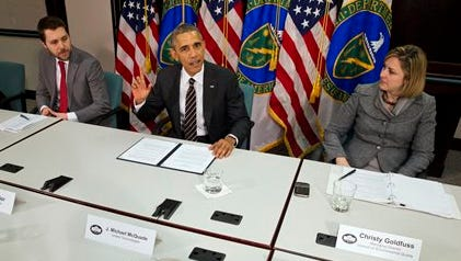 President Barack Obama, with senior adviser Brian Deese, left, and Christina Goldfuss, the managing director of the Council on Environmental Quality, speaks at Energy Department in Washington on March 19, 2015.  In a highly anticipated announcement, the U.S. will pledge to cut its greenhouse-gas emissions by up to 28%  as its contribution to a major global climate treaty nearing the final stages of negotiation, according to people briefed on the White House's plans.
