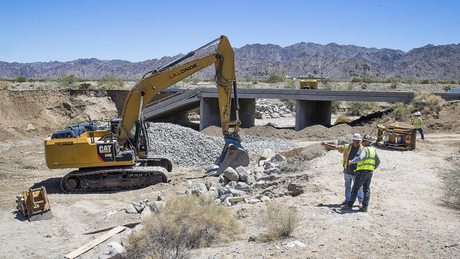 Crews work to repair the Tex Wash Bridge on Interstate 10, west of Blythe, Calif.