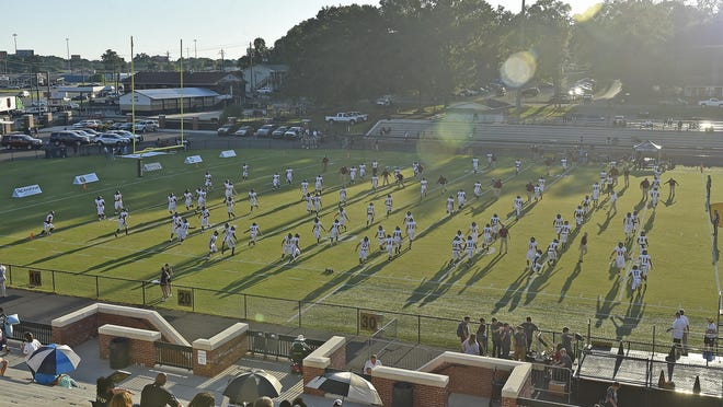 The Gadsden City Titans go through warm ups during high school football action in Oxford on Aug. 30, 2019.