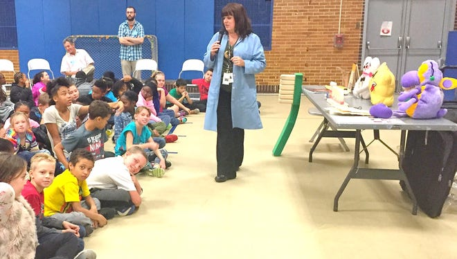 """Diana Gatens shares information about oral health with kindergarten and first-grade students at R.M. Bacon Elementary School in Millville during """"Project BRUSH,"""" an oral health program."""