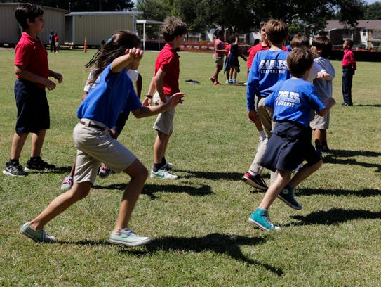 Fourth graders play during recess at Woodvale Elementary