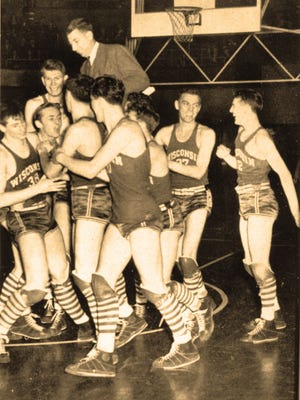 The 1941 Wisconsin Badgers celebrate winning the NCAA tournament.