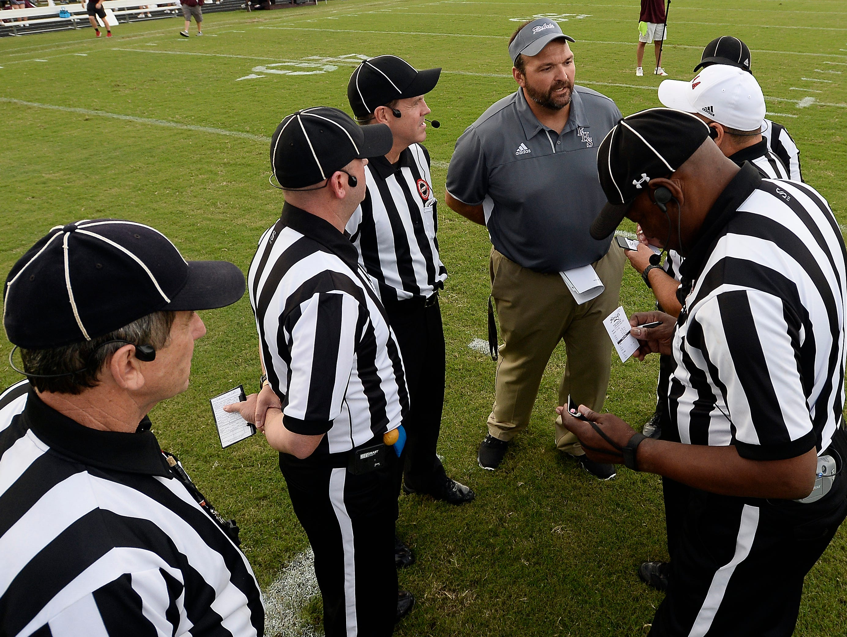 Franklin head coach Donnie Webb, top center, talks with TSSAA high school referees before the start of a game against Centennial on Friday, August 19, 2016, in Franklin.