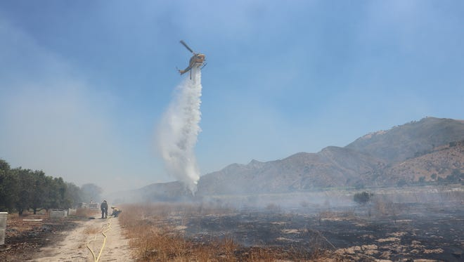 Firefighters responded to a brush fire Sunday afternoon in Piru near the intersection of Torrey and Howe roads.
