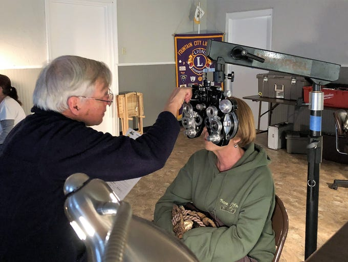Optometrist David Geldmeier refines a client's prescription.