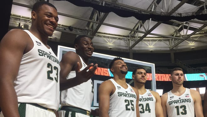 From left, Michigan State's big men Xavier Tillman, Jaren Jackson Jr., Kenny Goins, Gavin Schilling, Ben Carter and Nick Ward stand behind forward Miles Bridges on Wednesday, Oct. 11, 2017 at media day at Breslin Center in East Lansing.