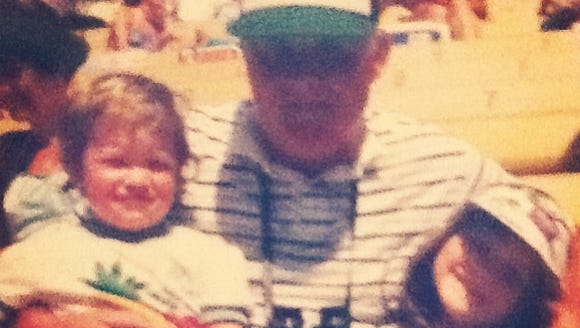 From left, me, Grandpa Hal, and my sister at the track.