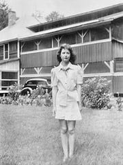 Debbie Fletcher's mother, Betty Richardson, stands outside the lodge in a 1930s photo.