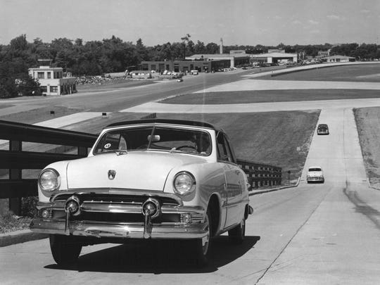 A Ford car climbing 17 percent grade on the test hill made for performance test at Ford Motors Company's test track at Dearborn.