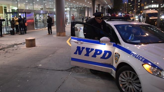 A New York City Police Officer (NYPD) is seen at the entrance to  Bellevue  Hospital October 23, 2014 after a doctor who recently returned to New York from West Africa was rushed  with a fever t o be tested for possible Ebola, the city's health department said.  The preliminary test results are expected in the next 12 hours.    Bellevue is one of three hospitals in Manhattan and eight in the state of New York equipped to handle patients diagnosed with Ebola.