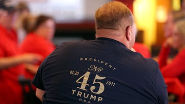 Bob Davis watches as Donald Trump becomes the 45th President of the United States during the inauguration on Friday, Jan. 20, 2017, at Hard Knocks Sports Bar in Corpus Christi, Texas.