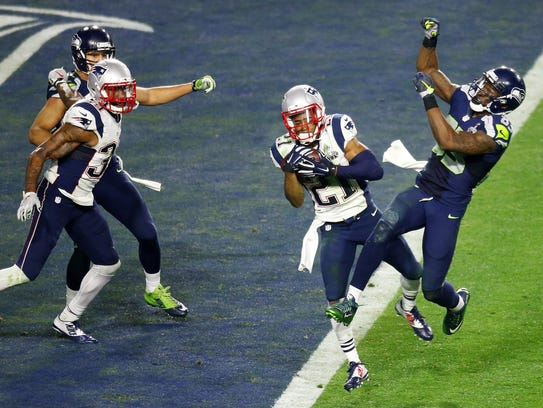 Malcolm Butler intercepts a pass intended for Ricardo Lockette in the closing minute of Super Bowl XLIX on Feb. 1, 2015.