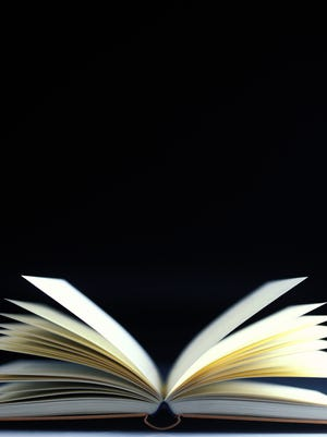 close-up of an open book with pages flying