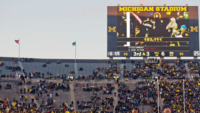 The Michigan Stadium student section sits mostly empty in the in the fourth quarter of an NCAA college football game between Michigan and Indiana in Ann Arbor, Mich., Saturday, Nov. 1, 2014. Michigan announced the attendance at the game was 103,111.