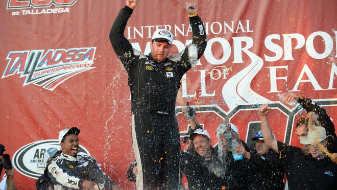 Blake Jones, 18, celebrates his victory in the ARCA Series auto race at Talladega Superspeedway, Friday, May 1, 2015, in Talladega, Ala. (AP Photo/David Tulis)