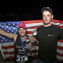 Poughkeepsie native Daniel Cartica, right, and Belmont, Massachusetts, resident Becca Pizzi celebrate after completing the seventh and final leg of the World Marathon Challenge on Jan. 30 in Sydney, Australia.