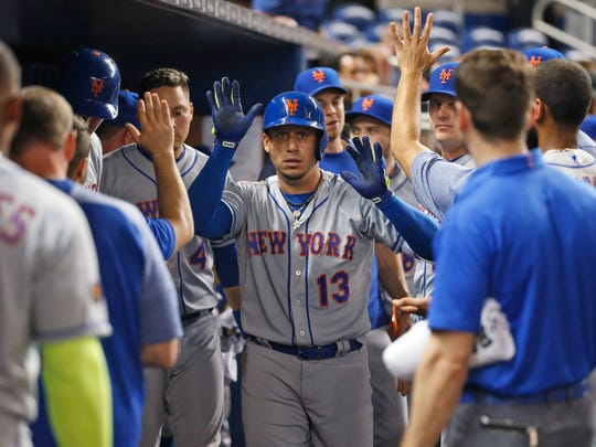 New York Mets' Asdrubal Cabrera (13) celebrates with