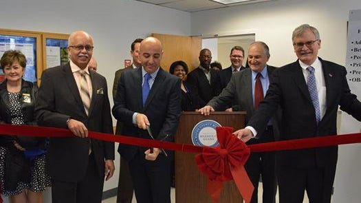 Cutting the ribbon to officially open the Wayne County Health Center in Wayne are Wayne County Executive Warren Evans (left); Dr. Mouhanad Hammami, director of the Department Health, Veterans and Community Wellness; Wayne County Commissioner Al Haidous, D-Wayne; and Dr. Mert Aksu, dean of the University of Detroit Mercy School of Dentistry.