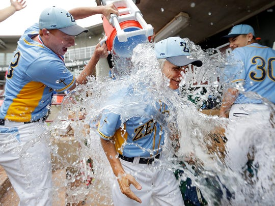 St. Mary Catholic players pour a cooler of water over the head of coach Phil Janssen during a celebration of the team's 5-1 victory over Prairie du Chien in a WIAA Division 3 state championship baseball game in 2016.
