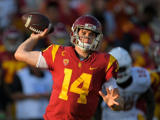 Southern California quarterback Sam Darnold throws during the first half of an NCAA college football game against Texas, Saturday, Sept. 16, 2017, in Los Angeles. (AP Photo/Mark J. Terrill)