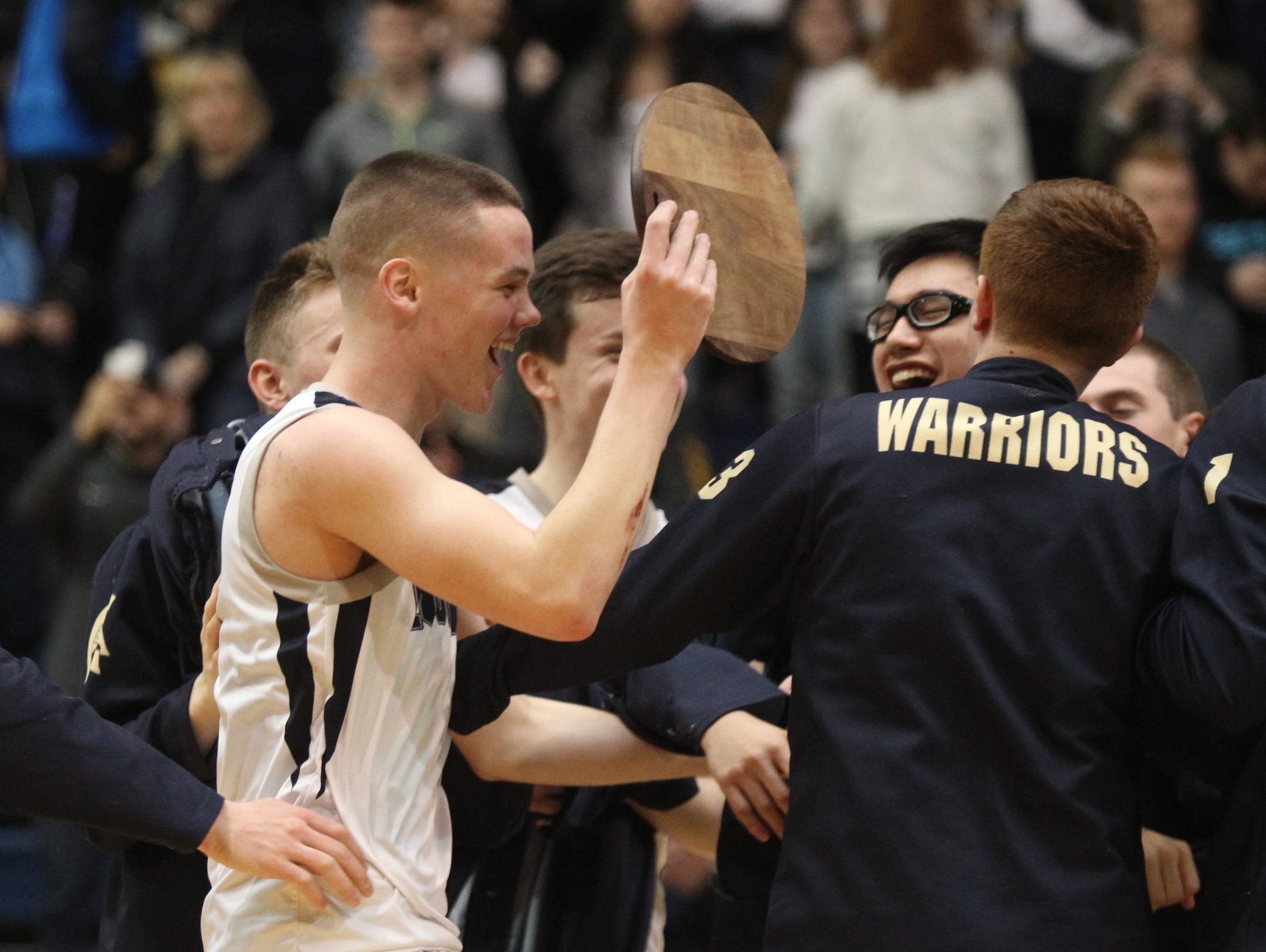Our Lady of Lourdes' Aidan Hilderbrand (5) reacts after defeating Poughkeepsie 61-46 in the boys NYSPHSAA Class A regional final at Pace University's Goldstein Center in Pleasantville on Saturday, March 11, 2017.