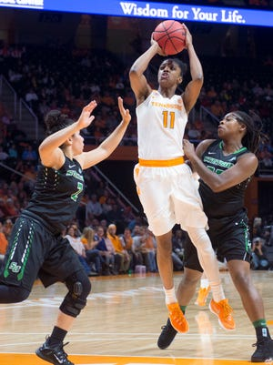 Tennessee's Diamond DeShields attempts to score while defended by Stetson's McKenna Beach, left, Breana Bey on Dec. 30, 2015. DeShields finished with 30 points.
