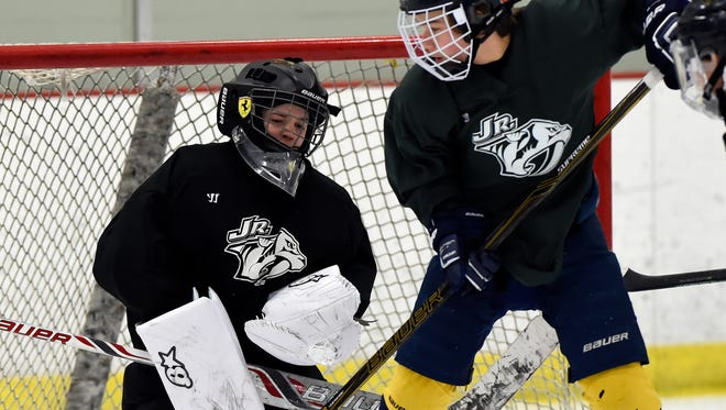 Nashville Jr. Predators 2002 Bantam Minor goalie Ian Farrar blocks a shot by Tanner Watkins, right, during practice at Centennial Sportplex on Tuesday.