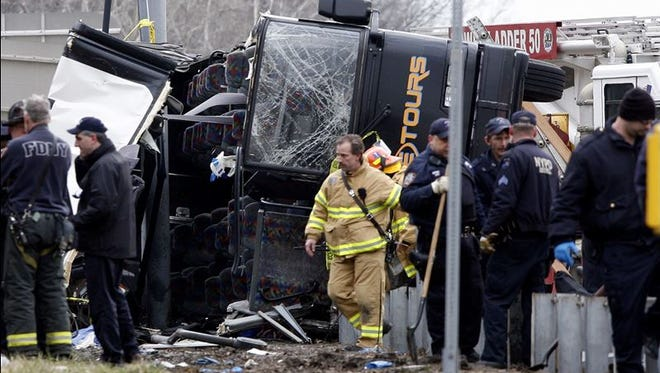 Emergency personnel investigate the scene of a bus crash on I-95 in the Bronx  in March 2011.