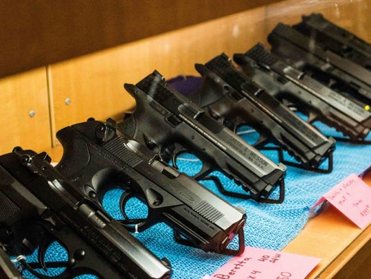 A row of guns for sale at G & G Retailers of Davenport,