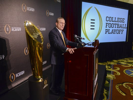 Jeff Long, College Football Playoff selections committee chairman, discusses the selection process of the semifinal pairings and semifinal bowl assignments during a news conference Sunday, Dec. 7, 2014, in Grapevine, Texas.