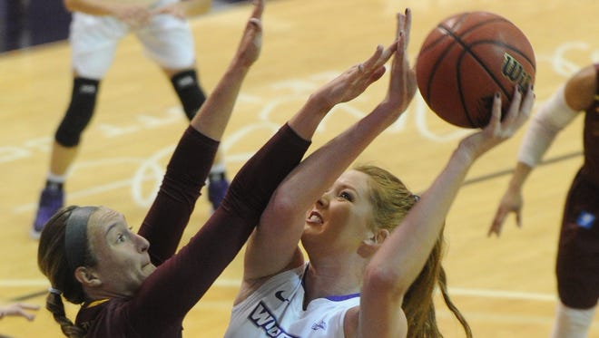 ACU's Lexi Kirgan (25) shoots over Midwestern State's Avery Queen. The Wildcats beat Midwestern 88-67 in a nonconference game Saturday, Dec. 16, 2017 at Moody Coliseum.