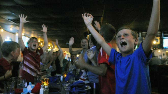 Scott Larson, 8, celebrates the United States first goal against Germany in the World Cup semifinal at Claddagh On The Shore on June 30.