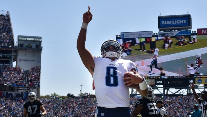 Tennessee Titans quarterback Marcus Mariota (8) celebrates his touchdown as he rushes into the end zone past the Oakland Raiders defense during the first half at Nissan Stadium Sunday, Sept. 10, 2017 in Nashville, Tenn.