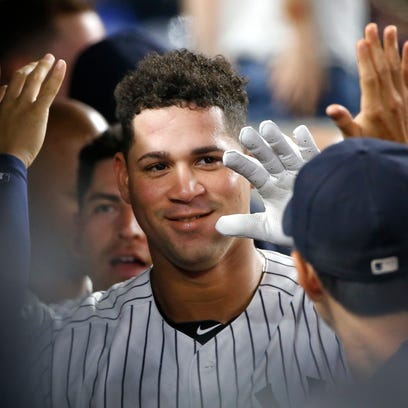 Teammates celebrate with New York Yankees' Gary Sanchez,