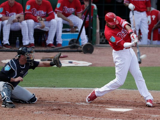 Philadelphia Phillies' Aaron Altherr, right, hits a solo home run during the fourth inning of a baseball spring exhibition game against the New York Yankees, Thursday, March 1, 2018, in Clearwater, Fla. At left is Yankees catcher Austin Romine. (AP Photo/Lynne Sladky)