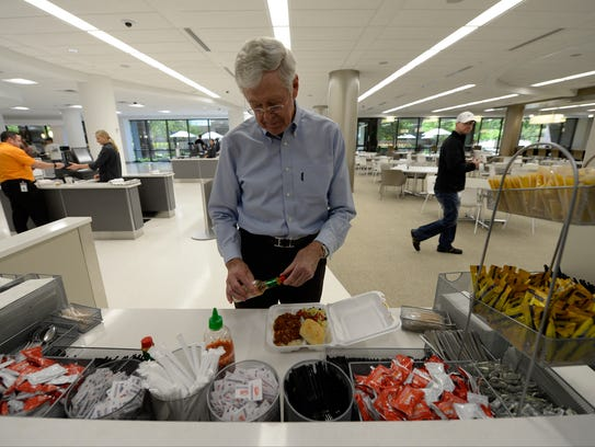 Charles Koch gets his lunch in the company cafeteria
