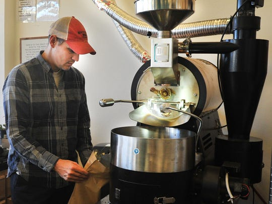 Odd Ducks Coffee, owner, Ted Klopf operates the store's bean roasting machine Monday morning. Ted and his wife Andrea operate their downtown Wichita Falls store located in the Big Blue building.