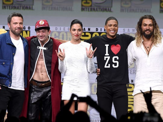 'Justice League' stars Ben Affleck (from left), Ezra Miller, Gal Gadot, Ray Fisher and Jason Momoa gather onstage at Comic-Con during Warner Bros. Pictures' presentation.