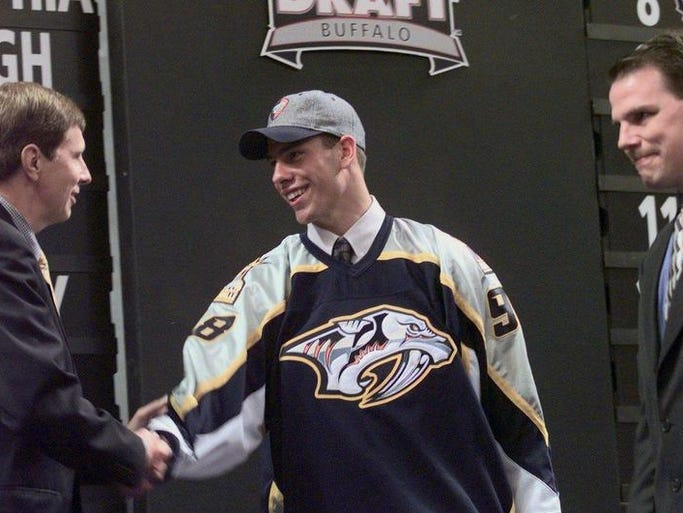 Predators general manager David Poile congratulates Nashville first round draft pick in 1998, David Legwand of the Plymouth Whalers. Predators senior scout Craig Channell is at right.