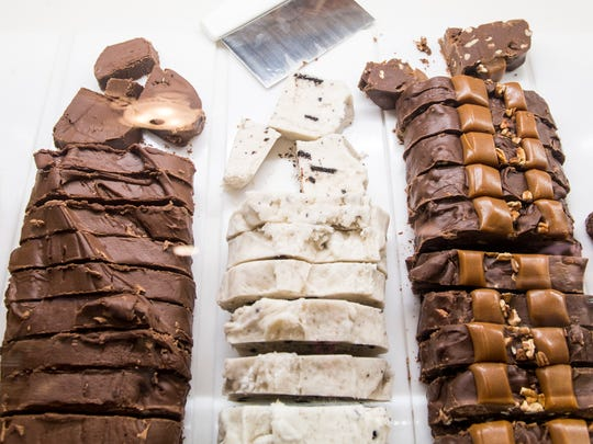 Various types of fudge for sale inside the Kilwins confections store on Gay Street in downtown Knoxville on Friday, March 23, 2018.