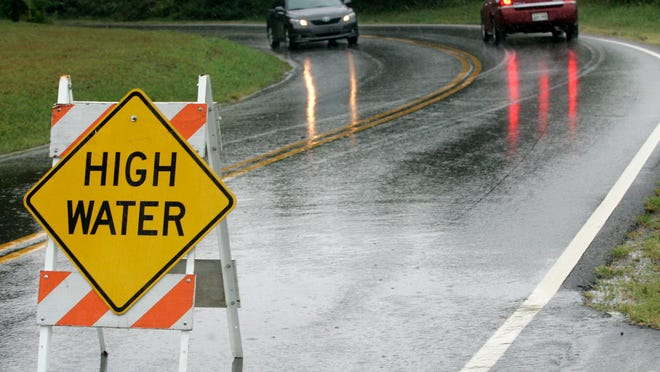 In this file photo, traffic ignores the HIgh Water signs on College Street near the underpass.